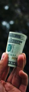 Budget Money Roll  in Guy Hand